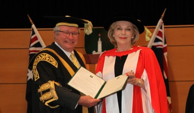 Chancellor The Hon Michael Egan AO presents Ita Buttrose AO OBE with the honorary doctorate. Credit: Dermot Walsh