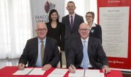 Signing of the partnership agreement with Vice-Chancellor Professor S Bruce Dowton; Robyn Chu, Director of Health Outcomes and Market Access at Johnson and Johnson Medical; Deputy Vice-Chancellor (Corporate Engagement and Advancement) Professor David Wilkinson; Margaret Hudson, Director Corporate Engagement Macquarie University and Managing Director Johnson and Johnson Medical, Gavin Fox-Smith. Photo: Chris Stacey.